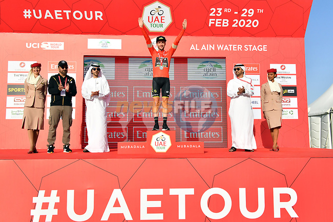 Race leader Adam Yates (GBR) Mitchelton-Scott retains the Red Jersey atop Jebel Hafeet at the end of Stage 5 the Al Ain Water Stage of the UAE Tour 2020 running 162km from Al Ain to Jebel Hafeet, Dubai. 27th February 2020.<br /> Picture: LaPresse/Massimo Paolone   Cyclefile<br /> <br /> All photos usage must carry mandatory copyright credit (© Cyclefile   LaPresse/Massimo Paolone)