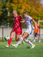 29 September 2013: Stony Brook University Seawolves Forward Shannon Grogan, a Junior from Eastampton, NJ, battles University of Vermont Catamount Forward/Defender Haley Marks, a Senior from Penfield, NY at Virtue Field in Burlington, Vermont. The Lady Seawolves defeated the Catamounts 2-1 in America East play. Mandatory Credit: Ed Wolfstein Photo *** RAW (NEF) Image File Available ***