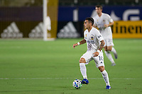 CARSON, CA - SEPTEMBER 19: Cristian Pavon #10 of the Los Angeles Galaxy moves with the ball during a game between Colorado Rapids and Los Angeles Galaxy at Dignity Heath Sports Park on September 19, 2020 in Carson, California.