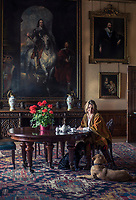 The Countess of Carnarvon with her dogs in an anteroom at Highclere Castle