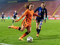 BREDA, NETHERLANDS - NOVEMBER 27: Lieke Martens #11 of the Netherlands is defended by Kelley O'Hara #5 of the USWNT during a game between Netherlands and USWNT at Rat Verlegh Stadion on November 27, 2020 in Breda, Netherlands.
