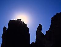 Sunburst over rock formation. Monument Valley, AZ