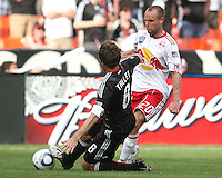 Carey Talley #8 of D.C. United slides into Joel Lindpere #20 of the New York Red Bulls during an MLS match on May 1 2010, at RFK Stadium in Washington D.C.