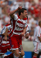 FC Dallas forward, Kenny Cooper, celebrates after scoring his first MLS goal on a header in the 70th minute of the 2006 season opener.  FC Dallas beat the Chicago Fire 3-2 at Pizza Hut Park on April 1, 2006.