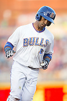 Alexi Casilla (12) of the Durham Bulls rounds the bases after hitting a home run against the Scranton/Wilkes-Barre RailRiders at Durham Bulls Athletic Park on May 15, 2015 in Durham, North Carolina.  The RailRiders defeated the Bulls 8-4 in 11 innings.  (Brian Westerholt/Four Seam Images)