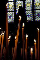 Candles burning inside the Basilica of the Saint Sauveur, Dinan, France.