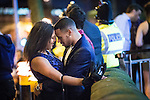 """© Joel Goodman - 07973 332324 . 19/12/2015 . Manchester , UK . An amorous couple . Revellers in Manchester enjoy """" Mad Friday """" - also known as """" Black Eye Friday """" - the day on which emergency services in Britain are typically at their busiest , as people head out for parties and drinks to celebrate Christmas . Photo credit : Joel Goodman"""