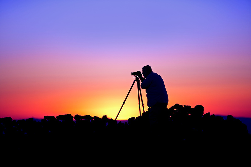 Photographer silhouette on rim of Steen Mountain. Oregon