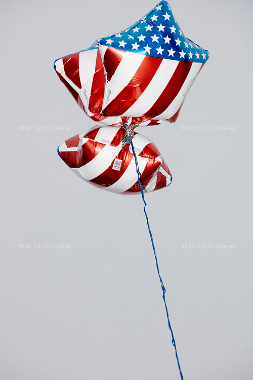 American flag balloons fly as people gather in the National Mall area of Washington, DC, for the Women's March on Washington protest and demonstration in opposition to newly inaugurated President Donald Trump on Jan. 21, 2017.
