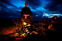 """Tulga, a guide, lights a bonfire in the grassland while escorting five-year-old autistic child Rowan and his family during a horseback expedition across Mongolia. Rowan, who has been nicknamed """"The Horse Boy"""", embarked on a therapeutic journey of discovery with his parents to visit a succession of shaman healers in one of the most remote regions in the world. Following Rowan's positive response to a neighbour's horse, Betsy, and some reaction to treatment by healers, Rowan's parents hoped that the Mongolian shamanistic rituals along the route and the prolonged contact with horses would help to unlock their son's autism and assist his development.."""