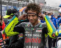 29th August 2021; Silverstone Circuit, Silverstone, Northamptonshire, England; MotoGP British Grand Prix, Race Day; Petronas Yamaha SRT rider Franco Valentino Rossi puts on a headband