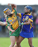 Amy Keating of Inagh-Kilnamona in action against Roisin Mc Mahon of Newmarket during their senior county final in Clarecastle. Photograph by John Kelly.