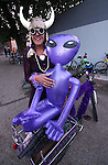 """Paula Gotchy poses with her bike, """"Elphaba"""", outside the Timbers Saloon during the first annual Blinky Man event in downtown Carson City, Nev., on Wednesday, June 19, 2013.<br /> Photo by Cathleen Allison"""