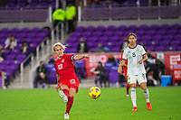 ORLANDO, FL - FEBRUARY 21: Sophie Schmidt #13 of the CANWNT kicks the ball during a game between Argentina and Canada at Exploria Stadium on February 21, 2021 in Orlando, Florida.