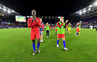 ORLANDO, FL - NOVEMBER 15: Gyasi Zardes #9 and Wil Trap #6 of the United States celebrate their victory over Canada 4-1 during a game between Canada and USMNT at Exploria Stadium on November 15, 2019 in Orlando, Florida.