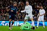 Gareth Bale of Real Madrid and Nacho Monreal (L) and Alex Ramiro (R) of Real Sociedad during La Liga match between Real Madrid and Real Sociedad at Santiago Bernabeu Stadium in Madrid, Spain. November 23, 2019. (ALTERPHOTOS/A. Perez Meca)