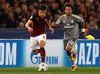 Calcio, andata degli ottavi di finale di Champions League: Roma vs Real Madrid. Roma, stadio Olimpico, 17 febbraio 2016.<br /> Roma's Diego Perotti, left, is chased by Real Madrid's Marcelo during the first leg round of 16 Champions League football match between Roma and Real Madrid, at Rome's Olympic stadium, 17 February 2016.<br /> UPDATE IMAGES PRESS/Riccardo De Luca