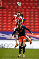 20th February 2021; Bet365 Stadium, Stoke, Staffordshire, England; English Football League Championship Football, Stoke City versus Luton Town; Nick Powell of Stoke City heads the ball clear of danger