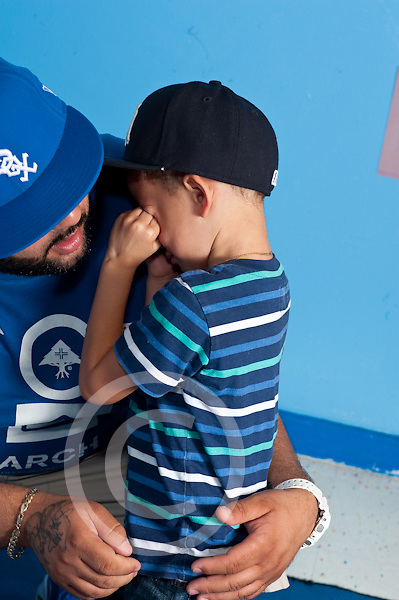 Education Preschool first days of school parent and child father comforting and reassuring apprensive son