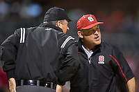 North Carolina State Wolfpack head coach Elliott Avent (right) argues a call at home plate with umpire Brian Kennedy during the game against the Charlotte 49ers at BB&T Ballpark on March 31, 2015 in Charlotte, North Carolina.  The Wolfpack defeated the 49ers 10-6.  (Brian Westerholt/Four Seam Images)