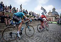 Jasper Stuyven (BEL/Trek-Segafredo) and Michael Valgren Andersen (DEN/Astana) up the infamous Kapelmuur. <br /> <br /> Binckbank Tour 2018 (UCI World Tour)<br /> Stage 7: Lac de l'eau d'heure (BE) - Geraardsbergen (BE) 212.7km