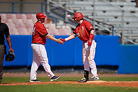 Bradley Braves coach Kyle Trewyn (44) congratulates Brendan Dougherty (26) after hitting a triple during a game against the Dartmouth Big Green on March 21, 2019 at Chain of Lakes Stadium in Winter Haven, Florida.  Bradley defeated Dartmouth 6-3.  (Mike Janes/Four Seam Images)