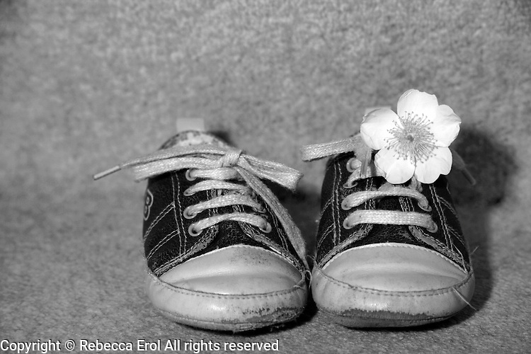 Pair of baby's shoes with a rose