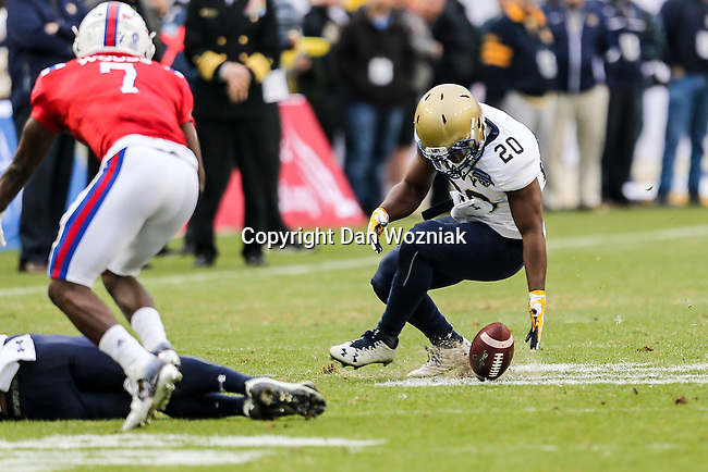 Navy Midshipmen running back Calvin Cass Jr. (20) in action during the Armed Forces Bowl game between the Louisiana Tech Bulldogs and the Navy Midshipmen at the Amon G. Carter Stadium in Fort Worth, Texas.