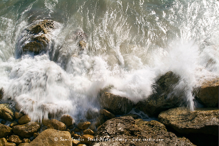 Waves crashing against the rocks at Le Prophete beach, Marseille, France.