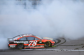 Monster Energy NASCAR Cup Series<br /> Hollywood Casino 400<br /> Kansas Speedway, Kansas City, KS USA<br /> Sunday 22 October 2017<br /> Martin Truex Jr, Furniture Row Racing, Bass Pro Shops / Tracker Boats Toyota Camry, does a burnout after winning.<br /> World Copyright: John K Harrelson<br /> LAT Images