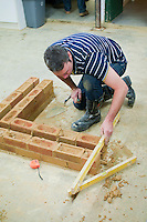 Student on a short bricklaying course before building his own garage at home.  Able Skills in Dartford, Kent, runs courses in construction industry skills like, bricklaying, carpentry and tiling.