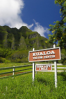 This sign along Kamehameha highway, invites visitors to stop in at the Kualoa Ranch for a day of nature tourism (ecotourist) activities. Located along Oahu's windward coast.