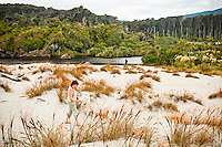 Woman on the beach at Ship Creek - South Westland, New Zealand