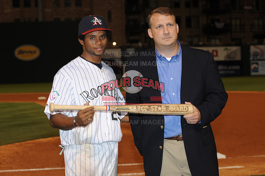 Asheville Tourists Eliezer Mesa presented by Eric Krupa the Top Star Award South Atlantic League All Star Game at Fluor Field in Greenville, South Carolina June 22, 2010.   The game ended in a 5-5 tie.  Photo By Tony Farlow/Four Seam Images