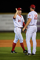 Greeneville Reds center fielder Mike Siani (34) high fives with Brandt Stallings (25) after a game against the Pulaski Yankees on July 27, 2018 at Pioneer Park in Tusculum, Tennessee.  Greeneville defeated Pulaski 3-2.  (Mike Janes/Four Seam Images)