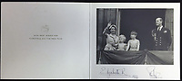 BNPS.co.uk (01202 558833)<br /> Pic: Rowleys/BNPS<br /> <br /> Pictured: 1954 with Charles and Anne on the balcony of Buckingham Palace sold for £160<br /> <br /> <br /> A series of Christmas cards sent by the Royal Family to a married couple on their staff over a 25 year period have sold for £2,000.<br /> <br /> Most of the cards were sent by the Queen and Prince Philip and show the changing face of the monarchy from the black-and-white post war world to the colourful 1970s.<br /> <br /> They were sent to the couple who worked at Balmoral, the wife in the house and the husband on the estate.<br /> <br /> The cards were sold individually with the most expensive being the one for Christmas 1947 which was signed by King George VI and the Queen Mother.