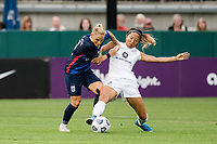 TACOMA, WA - JULY 31: Yuki Nagasato #17 of Racing Louisville FC and Jessica Fishlock #10 of the OL Reign battle for the ball during a game between Racing Louisville FC and OL Reign at Cheney Stadium on July 31, 2021 in Tacoma, Washington.
