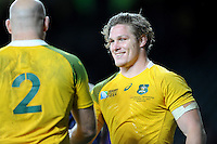 Michael Hooper of Australia looks happy as he shakes hands with Stephen Moore of Australia at the end of the Semi Final of the Rugby World Cup 2015 between Argentina and Australia - 25/10/2015 - Twickenham Stadium, London<br /> Mandatory Credit: Rob Munro/Stewart Communications