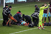 West Ham medical staff see to Winston Reid of West Ham who is injurd on the ground during the Premier League match between Swansea City and West Ham United at The Liberty Stadium, Swansea, Wales, UK. Saturday 03 March 2018