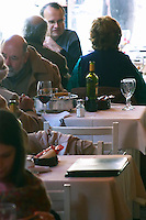 People having lunch in the busy restaurant, in the restaurant El Palenque, the sword fish swordfish, in the Mercado del Puerto, the market in the port harbour harbor where many people go and eat and shop on weekends Montevideo, Uruguay, South America