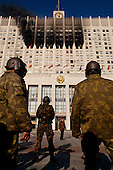 Moscow, Russia.October 4, 1993..Russian Special Forces take up position in front  of the Parliament building just before Russian tanks fired directly into the face of the building in hopes of removing hundreds of well armed anti-Yeltsin demonstrators held up inside. Numerous tank rounds were fired into the face of the building throughout the day with the upper floors catching fire and burning into the night...Russian troops surround the building and take control after killing or arresting the armed demonstrators.