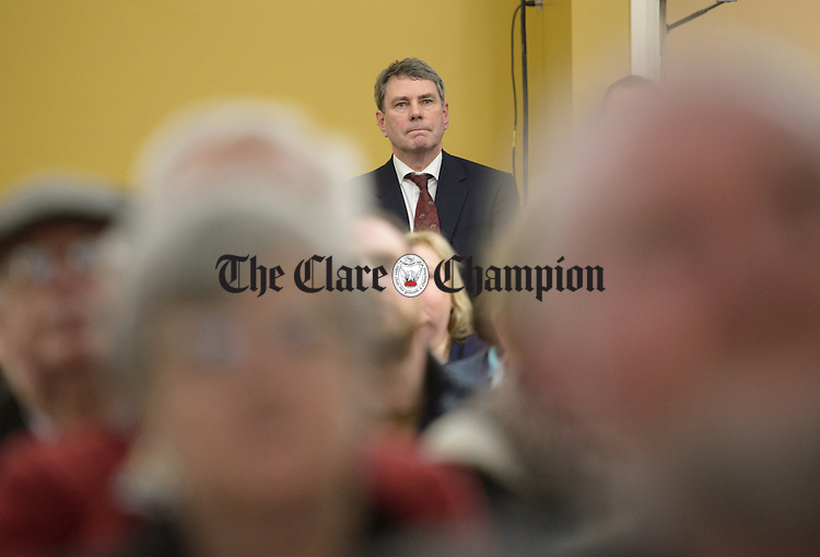 Dr. Michael Harty waits at the back of the hall to be introduced to the crowd during a public meeting as part of the #nodoctornvillage campaign in Corofin Hall. The meeting ratified Dr. Michael Harty as the Clare GP candidate for the forthcoming General election. Photograph by John Kelly.
