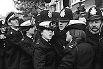 Willisden, London. 1977<br /> The police line, holding back demonstrators as they try to break through shouting at the 'scabs', those workers who refused to join the strike.  Everyday non-strikers were bussed into the factory owned by George Ward an Anglo Indian businessman. There were two shifts, the first around seven o'clock and the second a couple of hours later.