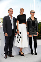 """CANNES, FRANCE - JULY 14: Vincent Lindon, Director Julia Ducournau and Agathe Rousselle at the """"Titane"""" photocall during the 74th annual Cannes Film Festival on July 14, 2021 in Cannes, France. <br /> CAP/GOL<br /> ©GOL/Capital Pictures"""