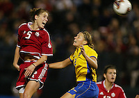 Andrea Neil, left, Karolina Westberg, right, Sweden vs. Canada, 2003 WWC.