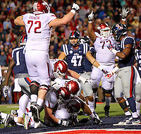 11/7/15<br /> Arkansas Democrat-Gazette/STEPHEN B. THORNTON<br /> Arkansas' teammates celebrate and pile on QB Brandon Allen after Allen dove over the goal line for the winning two point conversion in overtime to beat  Ole Miss  Saturday's game in Oxford, Miss.
