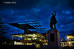 Dayton Metro Library construction project at dusk with William McKinley statue