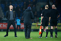 Manchester City manager Pep Guardiola walks away from the match officials after confronting referee Lee Mason after the final whistle of the Fly Emirates FA Cup Fourth Round match between Cardiff City and Manchester City at the Cardiff City Stadium, Wales, UK. Sunday 28 January 2018