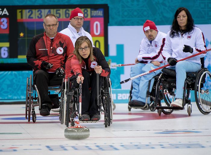 Dennis Thiessen and Ina Forrest, Sochi 2014 - Wheelchair Curling // Curling en fauteuil roulant.<br /> Canada competes against Norway in Wheelchair Curling round robin play // Le Canada affronte Norvège dans le tournoi à la ronde de curling en fauteuil roulant. 10/03/2014.