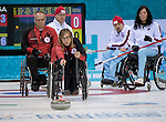 Sochi, RUSSIA - Mar 10 2014 -  Sonja Gaudet hurles her stone as Dennis Thiessen looks on Canada vs Norway in Wheelchair Curling round robin play at the 2014 Paralympic Winter Games in Sochi, Russia.  (Photo: Matthew Murnaghan/Canadian Paralympic Committee)